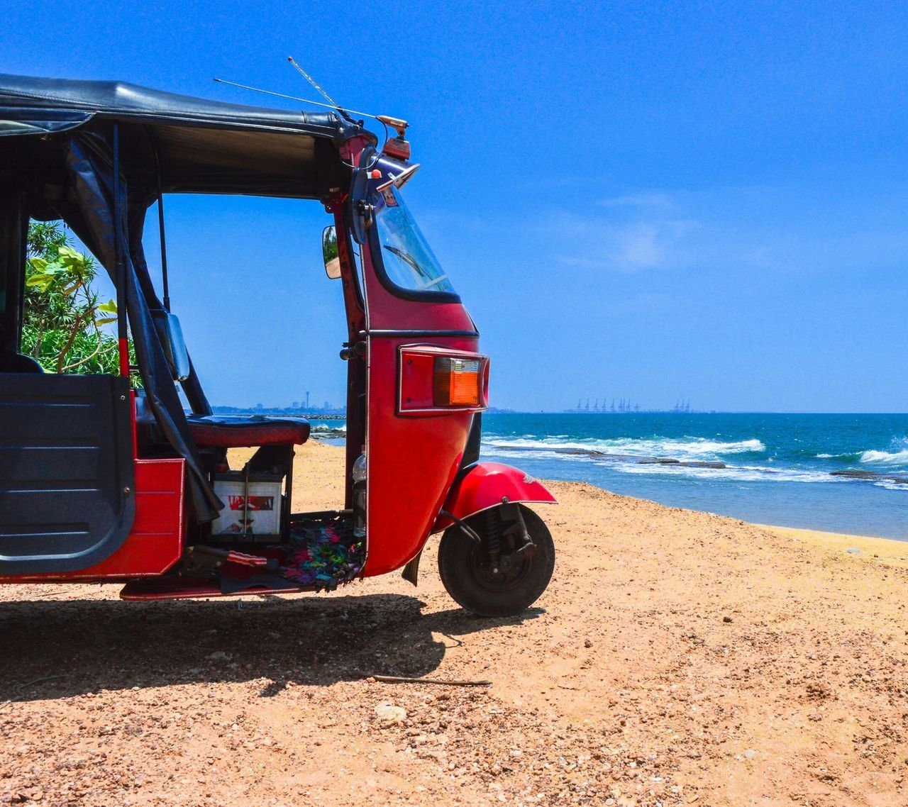 transportation, sea, mode of transport, sunlight, day, no people, red, outdoors, sky, beach, nature, horizon over water, beauty in nature