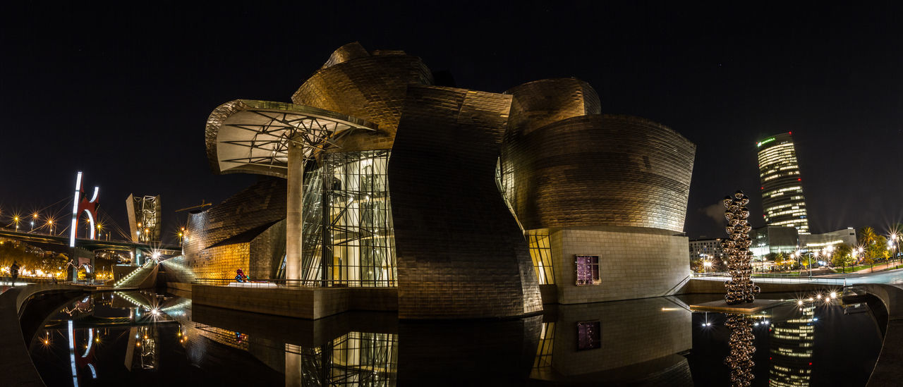 Guggenheim Museum in BIlbao Architecture Architecture_collection Bilbao Bilbaolovers Building Exterior Built Structure City Cityscape Eu Gold Colored Guggenheim Guggenheim Bilbao Guggenheimmuseum Illuminated Night No People Outdoors Panoramic Panoramic Photography Panoramic View Reflection Reflection_collection