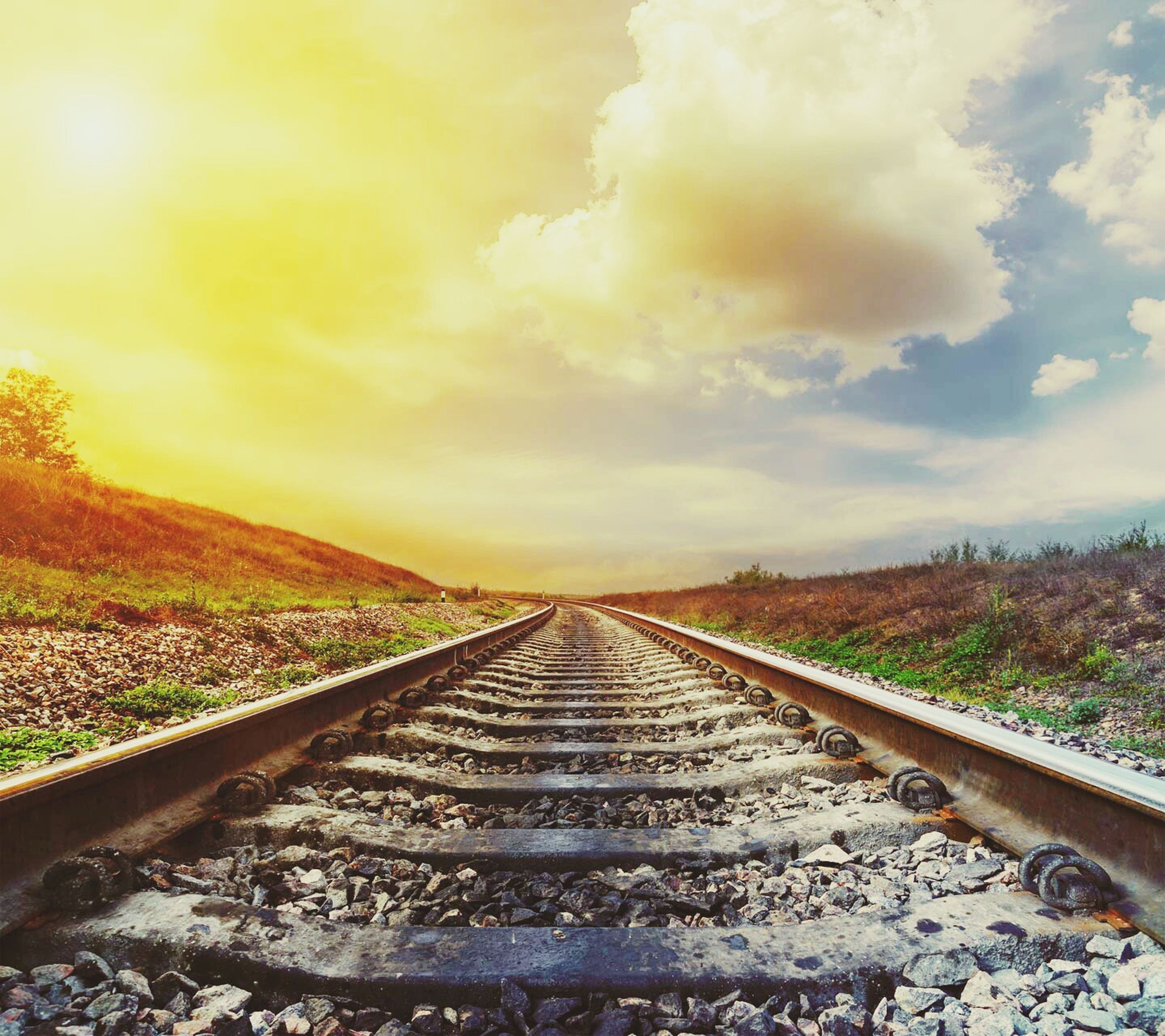 the way forward, diminishing perspective, sky, railroad track, transportation, vanishing point, cloud - sky, landscape, tranquility, tranquil scene, rail transportation, nature, scenics, cloud, cloudy, tree, beauty in nature, straight, outdoors, field