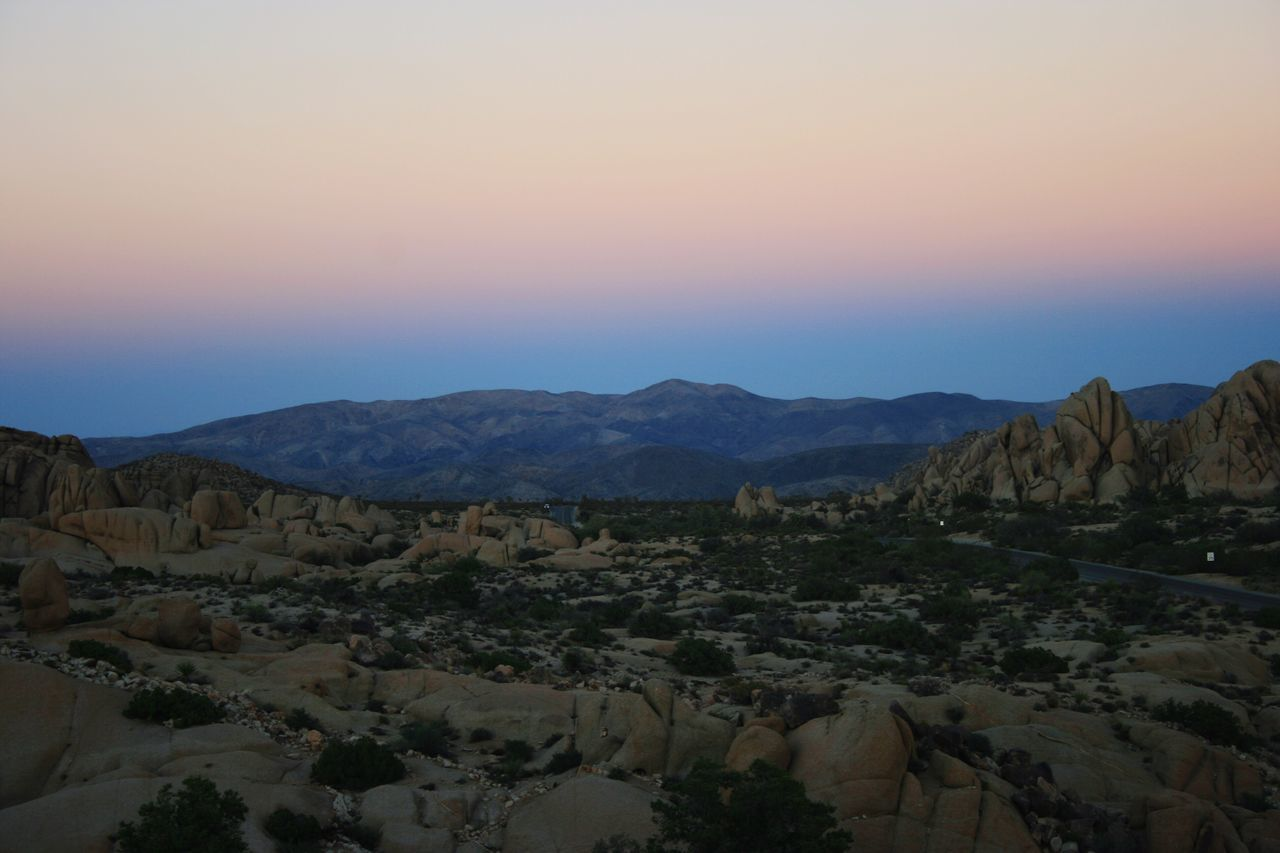 Mountain Beauty In Nature Nature Scenics Tranquil Scene Tranquility Mountain Range Physical Geography Geology Landscape Non-urban Scene Rock Formation Rock - Object Remote Arid Climate Idyllic No People Sunset Sky Outdoors Joshua Tree National Park Joshua Tree Jumbo Rock Joshua Tree Sunset