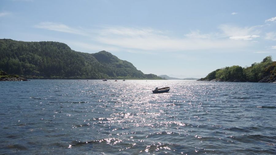 Tranquil Scene Water Outdoors Sea Sky Mountain Nature Highlands Stromeferry Scotland Loch Carron West Coast Scotland Highlands Of Scotland Sunlight Reflection In The Water Sunlight Reflection Boat