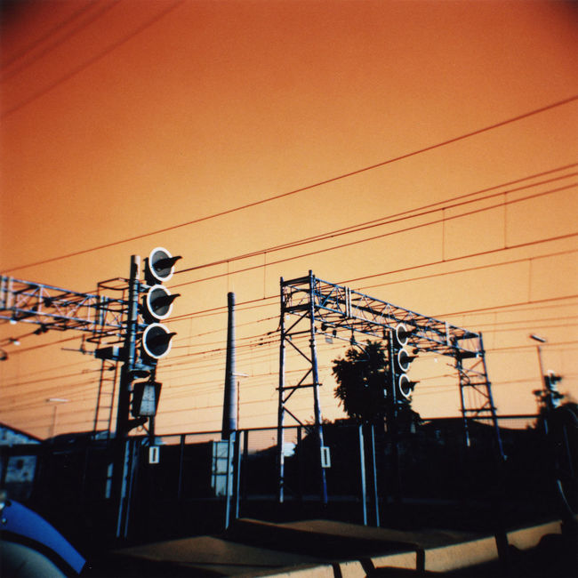 Urban wires 120 Film 6x6 Analog Analogue Analogue Love Analogue Photography Cables Cables And Wires Day Film Film Photography Filmisnotdead Holga Holga120 Lomochrome Turquoise Lomography No People Orange Outdoors Power Line  Railway Sky Turquoise Urban Wires