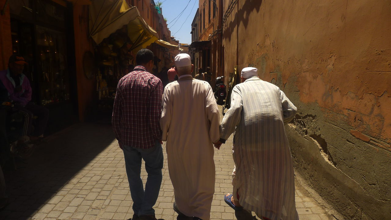 Arabic Men Arabic Style Architecture Back Of The Head Building Exterior Built Structure Casual Clothing City City Life Day Friends Friendship Leisure Activity Lifestyles Man From The Back :D Old Friends Outdoors Sky Sunlight Sunny The Way Forward Travel Destinations Tres Amigos