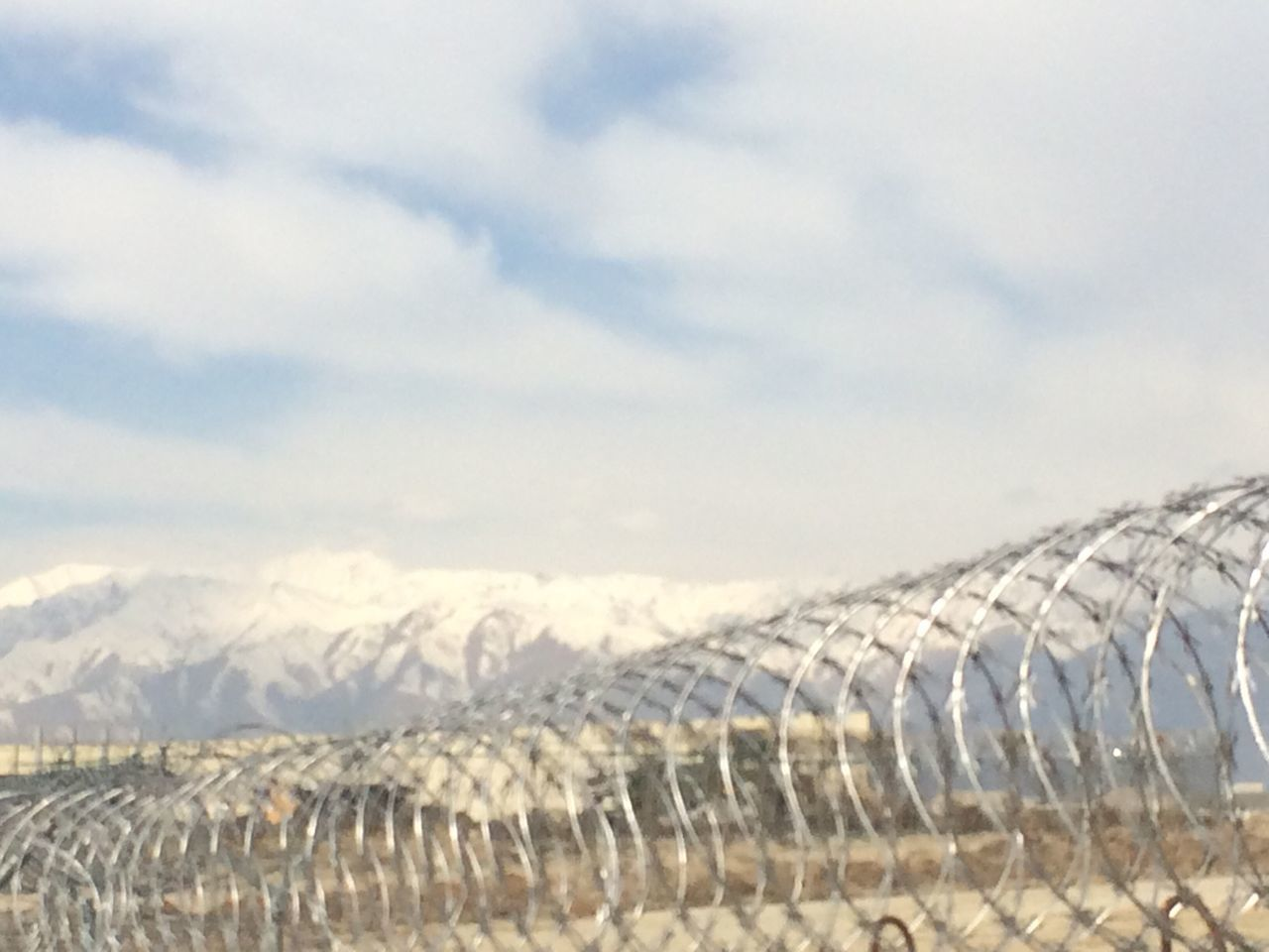 Sky No People Cold Temperature Outdoors Nature Day Winter Building Exterior Built Structure Architecture Cloud - Sky Mountain Landscape Beauty In Nature Razor Wire Fence