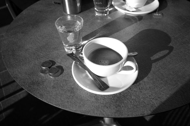 5 minutes 5 Minutes Bar Coffee Coffee Cup Coffee Time Drinks Espresso Euro Everyday Lives Food And Drink Geometric Shape Glass Glass Of Water Having A Break High Angle View Lifestyle Light And Shadow Money Monochrome Photography Pause Refreshment Round Shadow Table