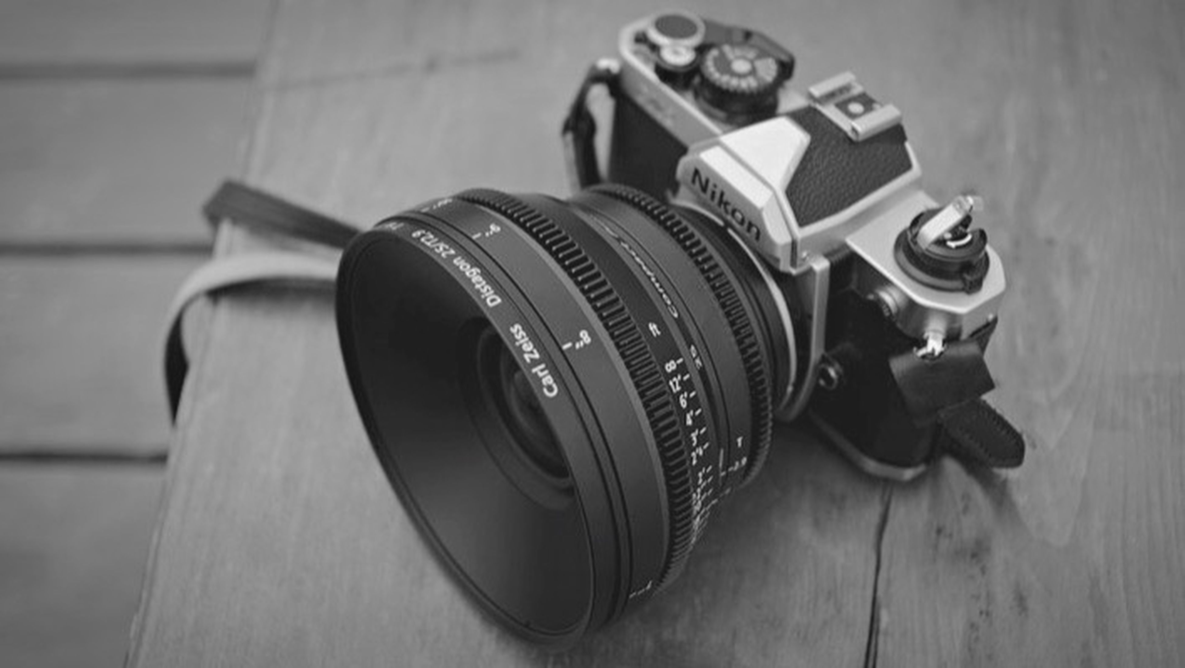 close-up, technology, indoors, still life, old-fashioned, focus on foreground, photography themes, selective focus, retro styled, wood - material, camera - photographic equipment, table, equipment, high angle view, metal, no people, day, single object, sunglasses, old