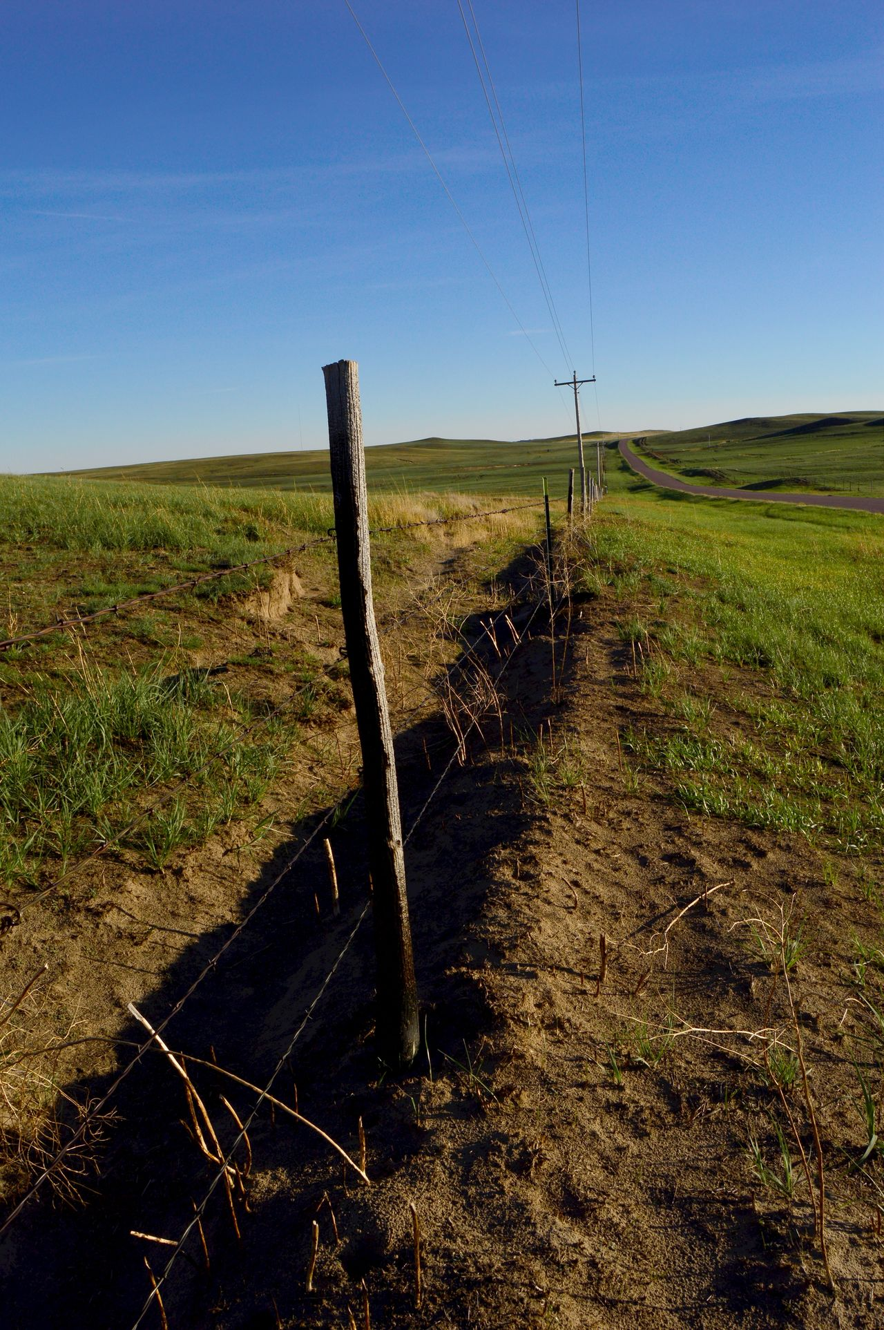 Rebuild fence Could See Smoke Quite A Few Mile Away Fire About 25 Miles Long & 3 Miles Wide Fire Was Back In July 2016 Miles Of Fence Were Burned In Fire Prairie Center Wyoming Remote Rural Scene Wind Blew Really Hard That Day