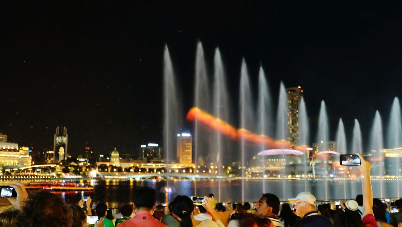 Marina Bay. Singapore. Celebration Celebration Event Night Built Structure Long Exposure Fountain Show Fountain Fun Fountain Architecture Building Exterior Water City Outdoors Large Group Of People Sky Reflections In The Water Night View Multi Colored Travelling Thailand Park - Man Made Space Downtown District Waterfront Travel Destinations Illuminated Modern