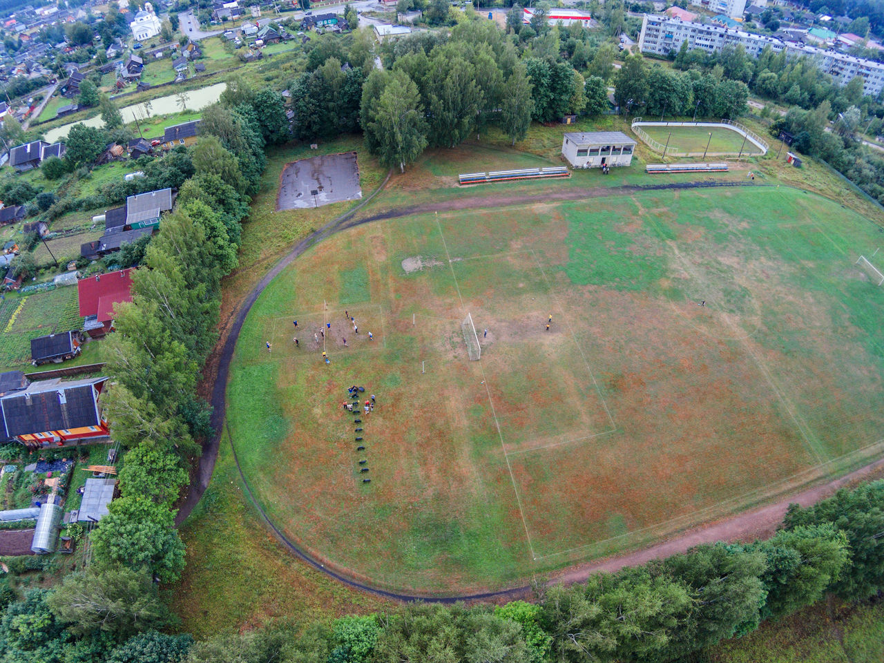 The football field of a small Russian provincial town. Aerial Aerial View Architecture City Cityscape Dji Dji Phantom Dronephotography Football Stadium Green Color High Angle View Maksatiha Maksatikha Outdoors Phantom Russia Small Town Sport Top Perspective Tree