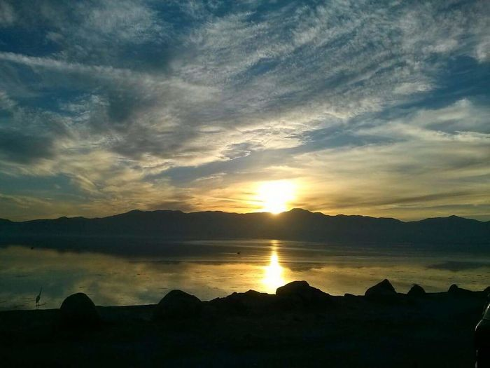 Reflection Sunset Landscape Nature No People Beauty In Nature Outdoors Sky Beauty In Nature Calisky From My Point Of View Smartphone Photography Smart Phone Photographer Cloud - Sky Tranquility Rewind My Hometown My Cali Life SoCal Dessert CaliLife Salton Sea Salton Sea, Digital Expression No Edit/no Filter This photo was also taken 3 years ago, during a visit home. It was a perfect sunset iver the Salton Sea. The sun, moon, wind, and clouds acted together in perfect harmony to allow me to capture this amazing shot.
