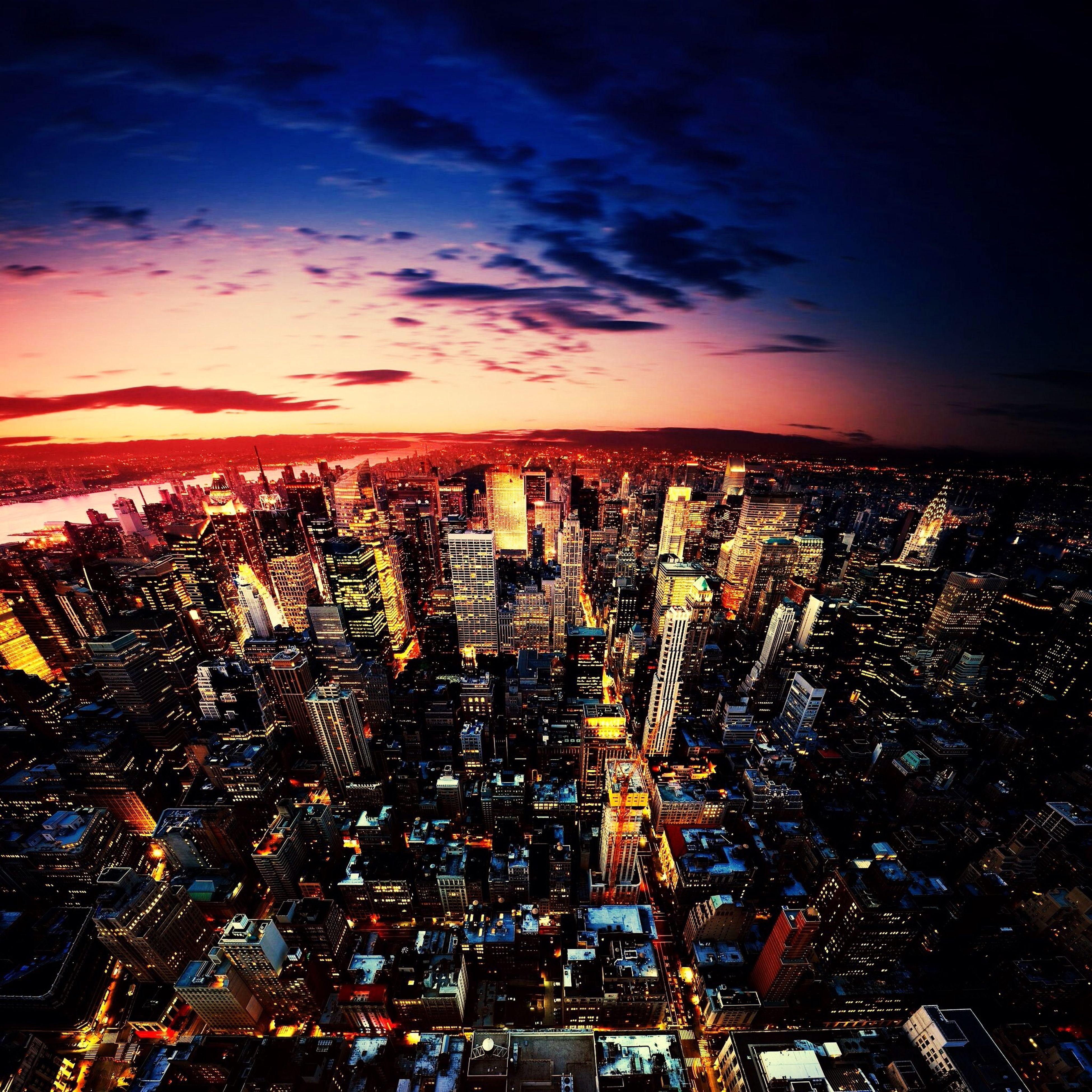 building exterior, city, architecture, cityscape, illuminated, built structure, sky, night, crowded, skyscraper, residential district, cloud - sky, residential building, residential structure, city life, modern, outdoors, tall - high, dusk, no people