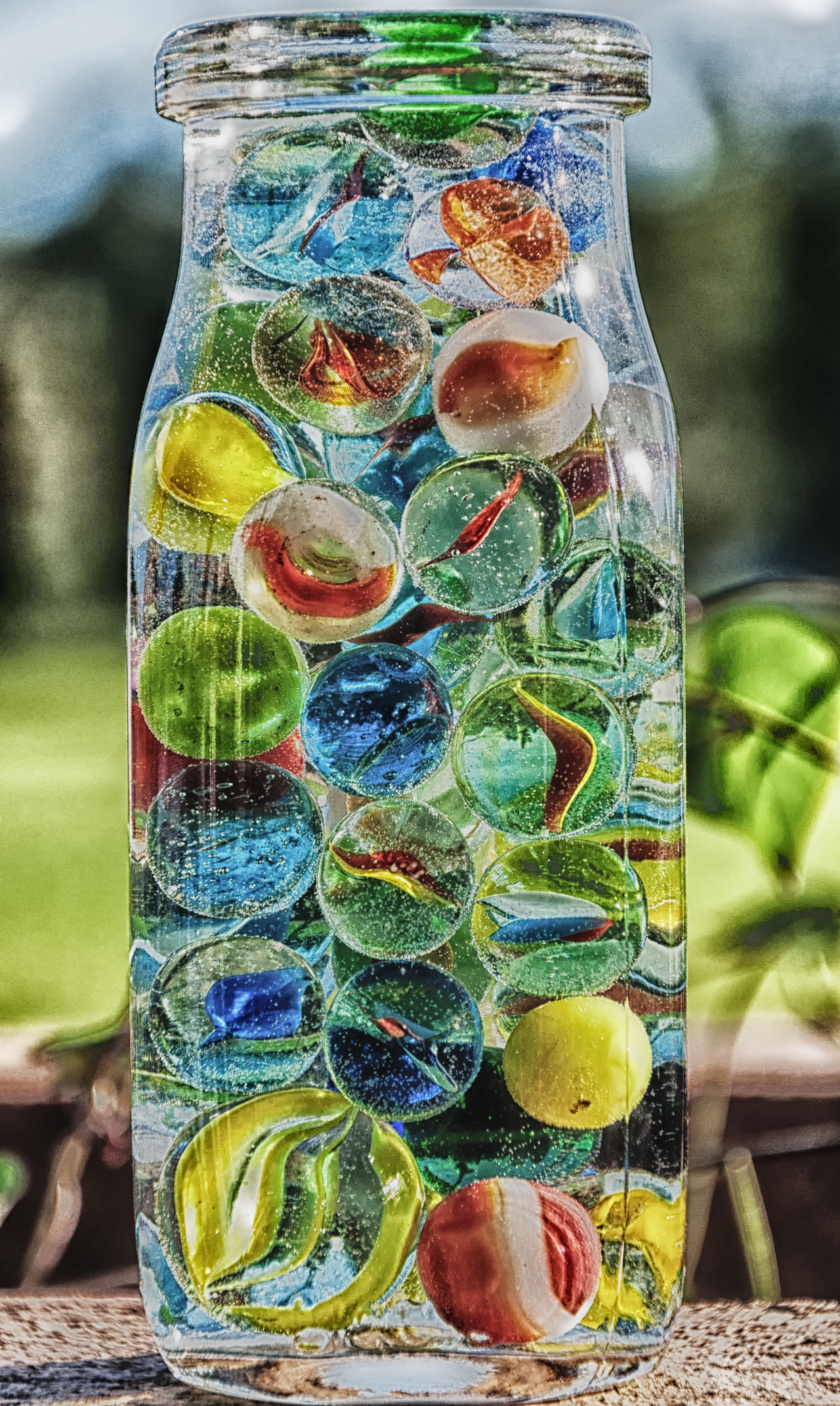 Don't lose your marbles Bottle Close-up Day Jar Marbles Multi Colored No People Outdoors Variation Water