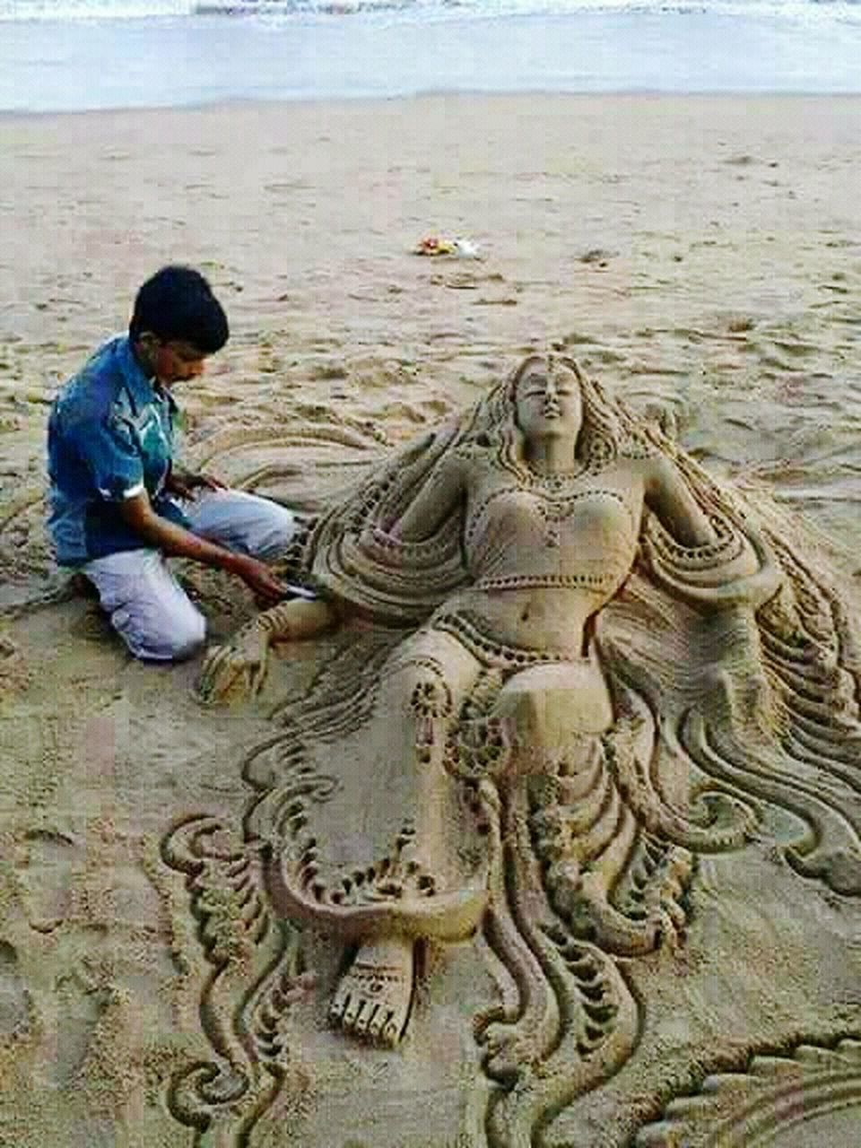 statue, sand, sculpture, beach, day, sitting, one person, outdoors, people, adult