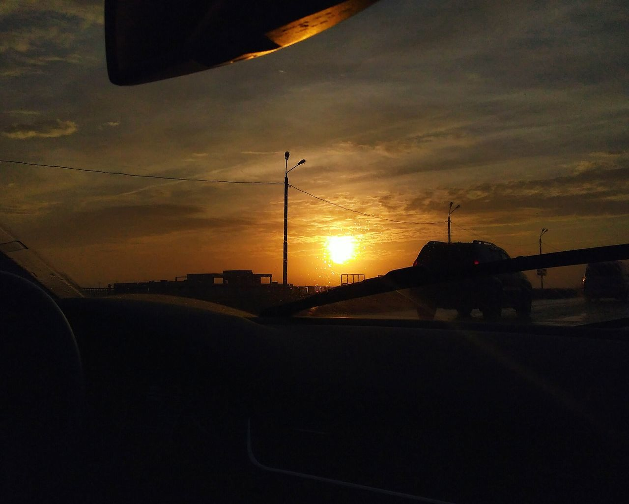 Car Sunset No People Sky Road Nature Dramatic Sky Beauty In Nature Outdoors Photo Magic Moments Enjoying LifePerfect View Sunset_captures Moment Sunset Silhouettes PhonePhotography Evening View Sunset_collection Nature_collection Emotions Wintertime Nature Beauty In Nature