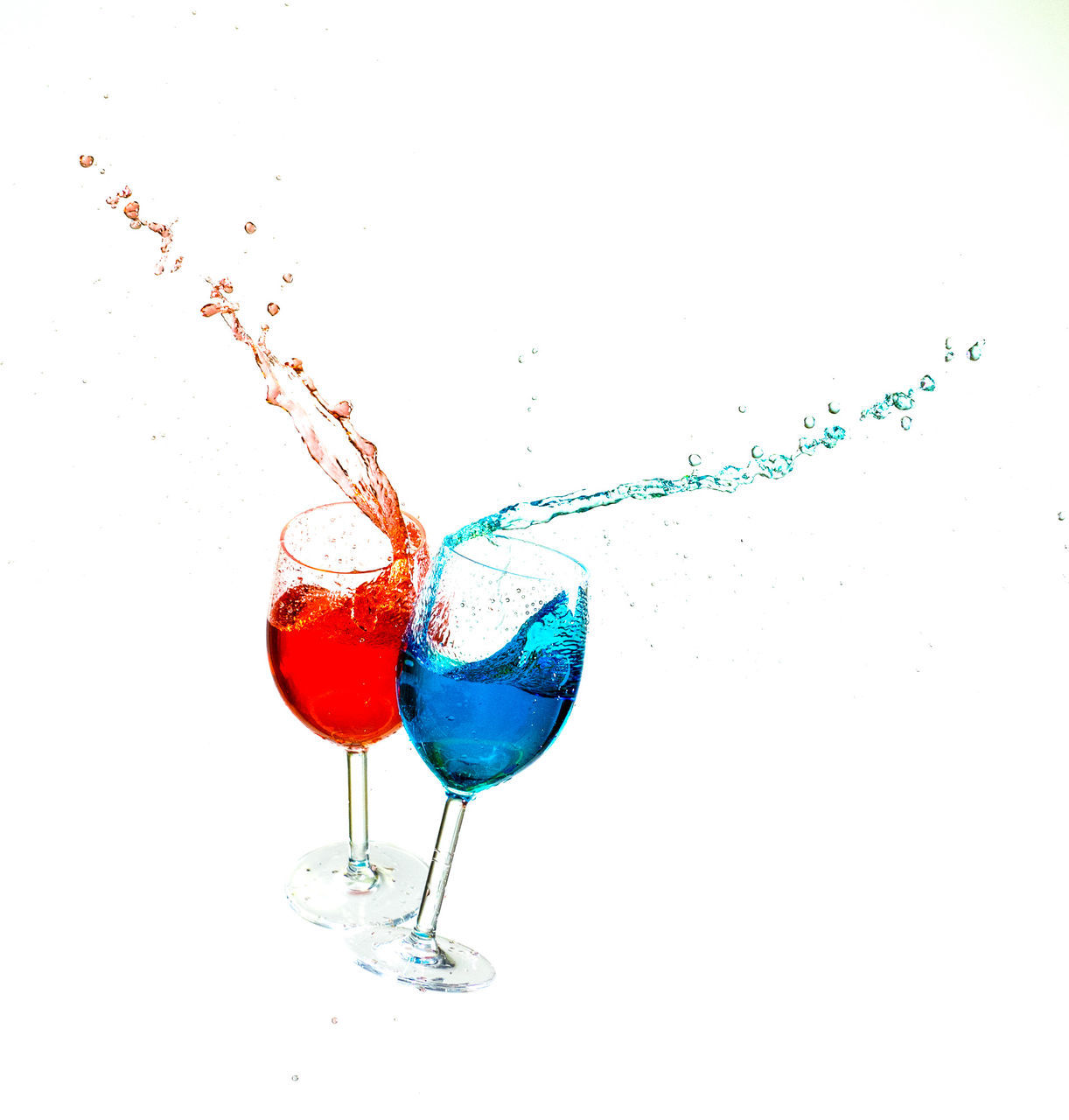 white background, studio shot, splashing, drink, cocktail, refreshment, drinking glass, no people, motion, red, alcohol, high-speed photography, close-up, freshness, day