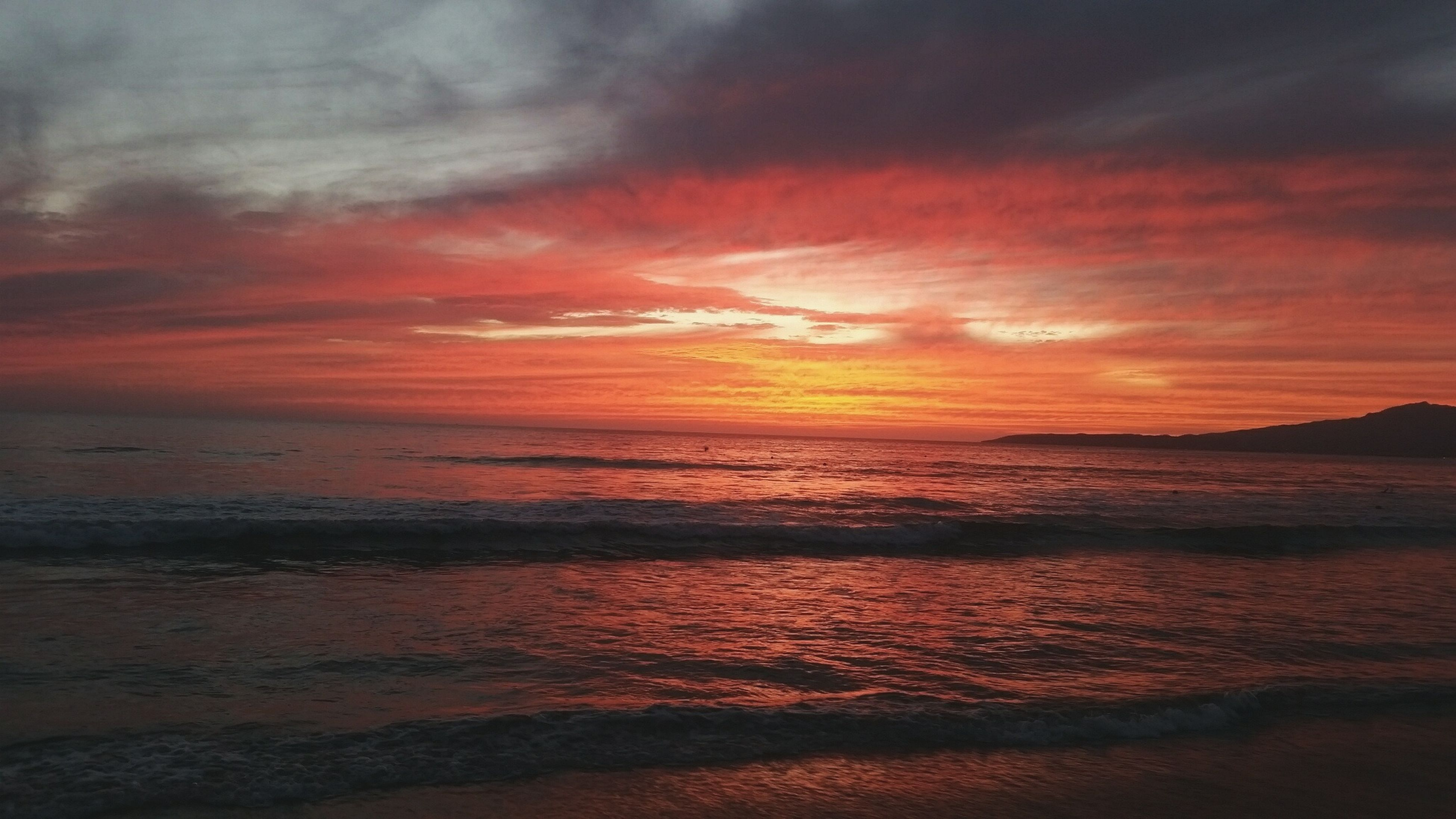 sea, sunset, beach, horizon over water, water, scenics, tranquil scene, beauty in nature, tranquility, sky, shore, orange color, idyllic, nature, sand, cloud - sky, wave, coastline, dramatic sky, remote