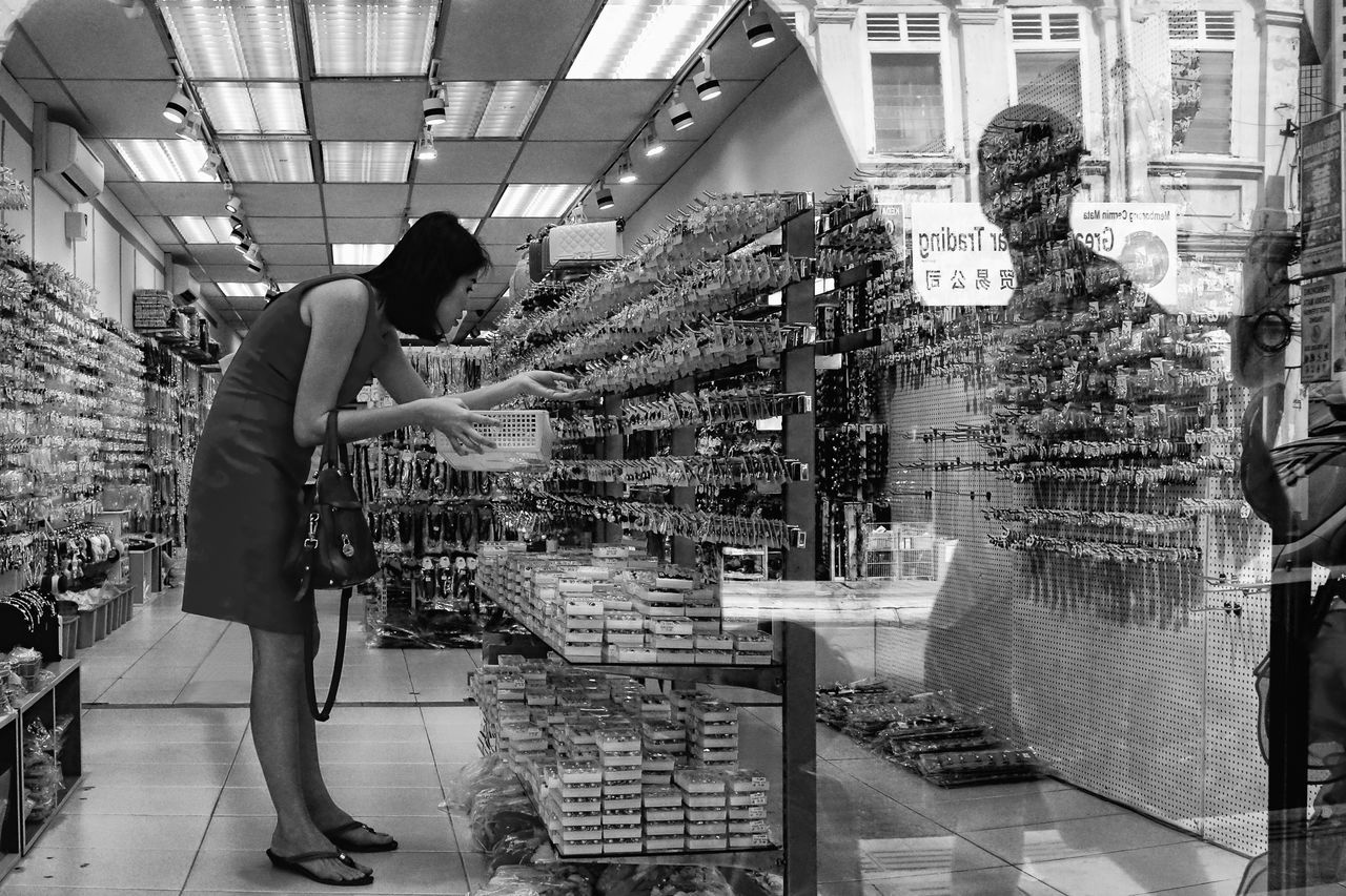 a lady picking up some accessories for her and maybe for her daughter too Accessories Accessories ❤ Adults Only Black And White Blackandwhite Blackandwhite Photography Day Healthcare And Medicine Indoors  Kuala Lumpur Kuala Lumpur Malaysia  One Person Only Women People Real Life Real People Reflection In The Window Reflections In The Glass Windows Store Women