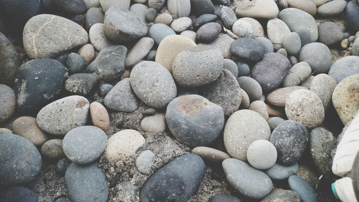 EyeEm Selects Pebble Full Frame Beach Backgrounds Pebble Beach Nature Large Group Of Objects Abundance No People Textured  Beauty In Nature Close-up Day Outdoors Best Photos New Talents The Week Of Eyeem EyeEm Best Shots Newest Talent Breathing Space