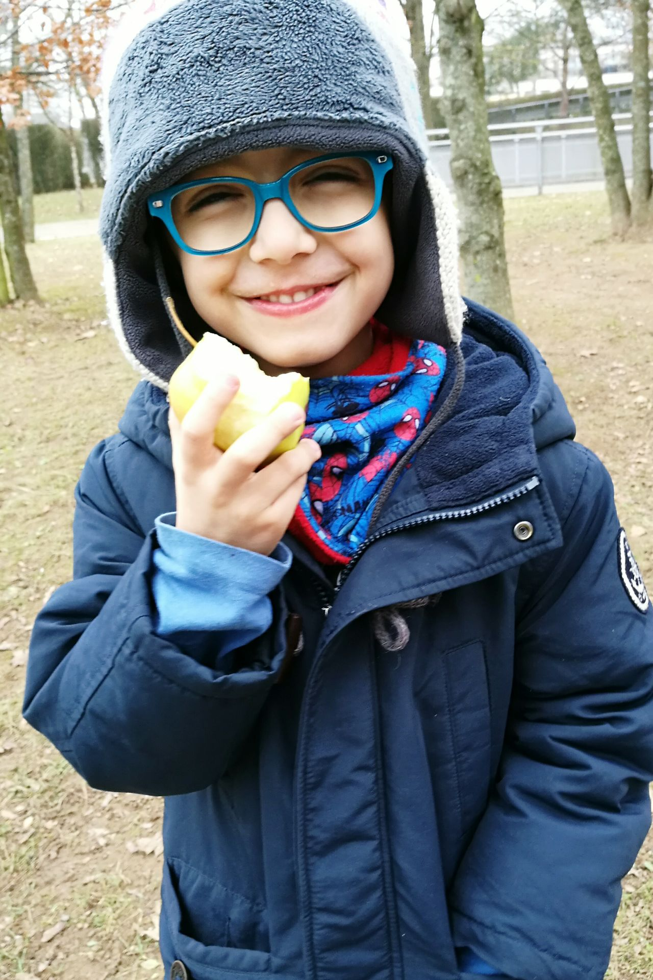 An apple a day... Eating Healthy Eating Apples Joy Children Photography Happy Smile Glasses Outdoors Luxembourg Streetphotography One Person Cheerful Childhood Portrait