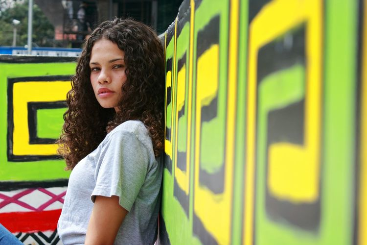 Cores. SP Brazil Grafiti Art Fotografia Photography Rua Jovem Sud Cores Indigino Indios Tribos Modelo Morena Cachos Transportation One Person Train - Vehicle Curly Hair Public Transportation Lifestyles One Young Woman Only Subway Train Only Women