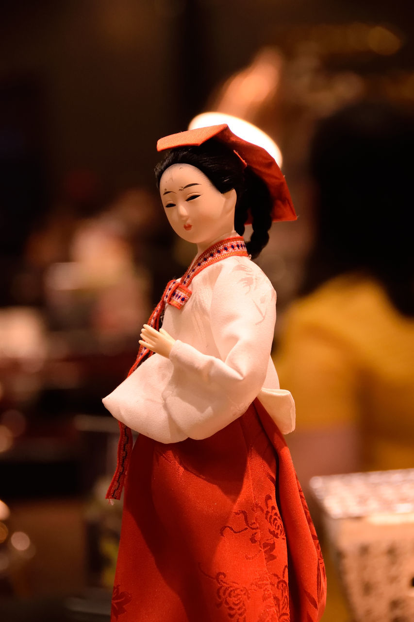 real people, one person, focus on foreground, fashion, traditional clothing, lifestyles, beautiful woman, leisure activity, red, standing, young adult, indoors, women, young women, day