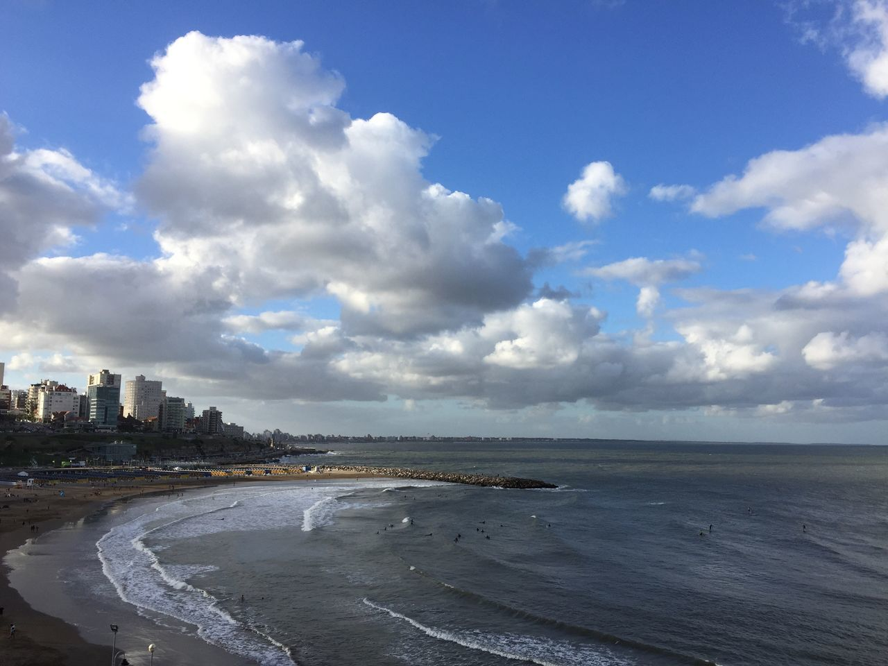 cloud - sky, sea, sky, architecture, water, built structure, travel destinations, city, beach, building exterior, scenics, skyscraper, cityscape, nature, outdoors, horizon over water, day, beauty in nature, no people, sand, modern, urban skyline