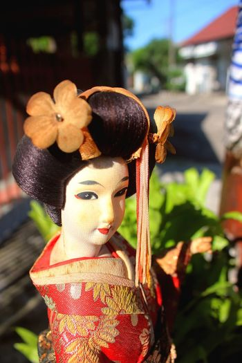 Focus On Foreground Flower Outdoors Japanese Doll Welcome Geisha Geisha Doll Dancing Kimono Doll Photography Doll Human Shape Gesture Colorful Daylight Sunlight And Shadow Sunlight Day Street Photography Street Woman Asian Culture ASIA Traditional Clothing Japan Finding New Frontiers