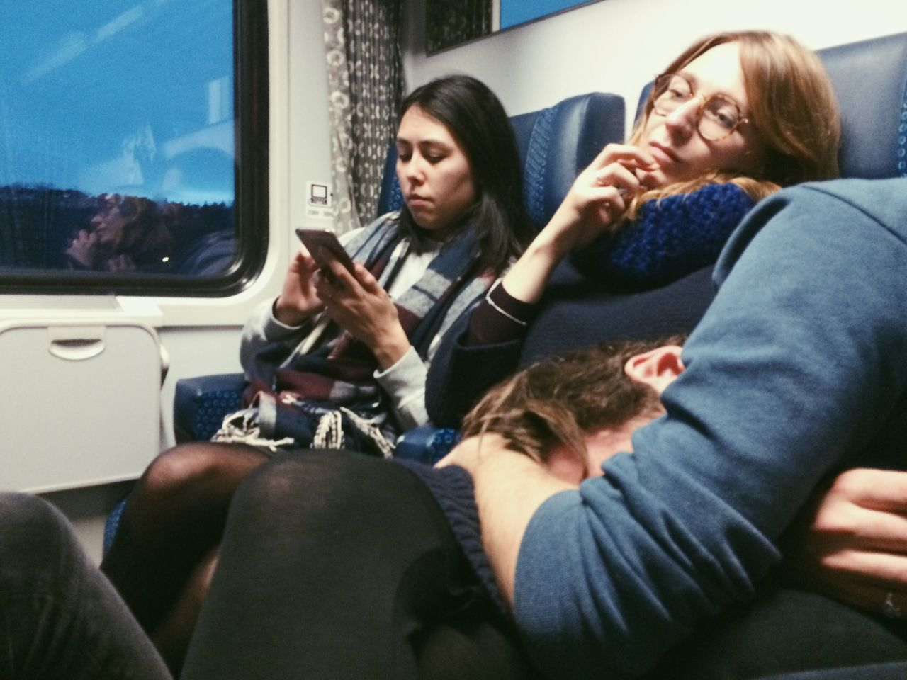 exhausted from traveling Vehicle Interior Transportation Casual Clothing Lifestyles Real People Passenger Sitting Two People Young Women Young Adult Land Vehicle Car Interior Indoors  Togetherness Day Adult Adults Only People Friends Exhausted Tired Bored Sleepy Mobile Device