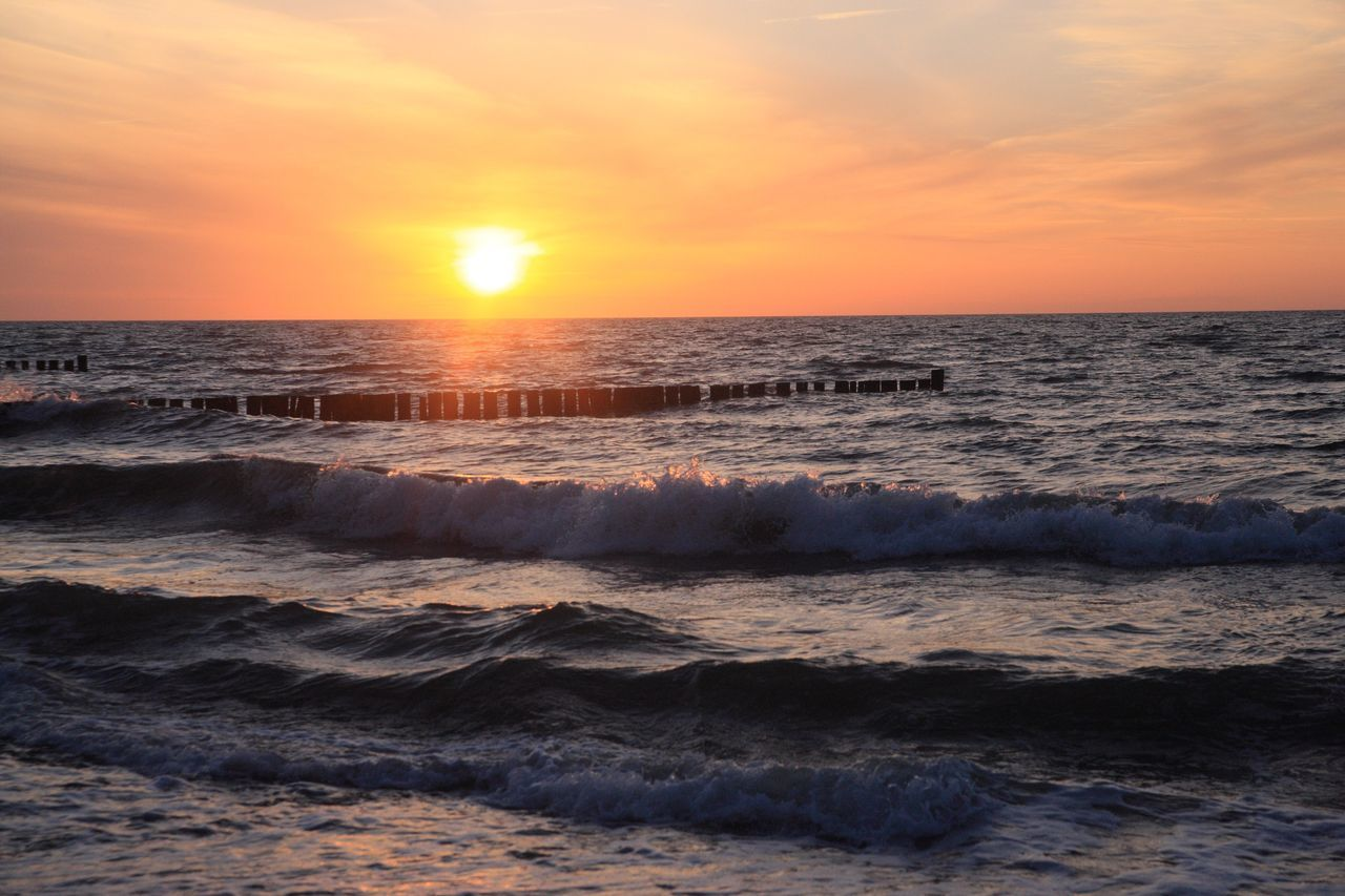 sunset, sea, beauty in nature, nature, horizon over water, scenics, sun, water, sky, wave, orange color, tranquility, sunlight, no people, idyllic, tranquil scene, outdoors, waterfront, beach, cloud - sky