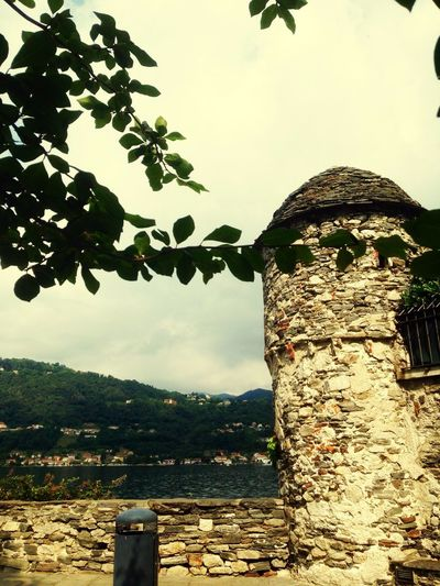 Isola di San Giulio Built Structure Mountain Day History Nature Sky No People Architecture Tree Outdoors Scenics Ancient Old Ruin Water Beauty In Nature Travel Destinations Building Exterior Clear Sky Close-up Ancient Civilization