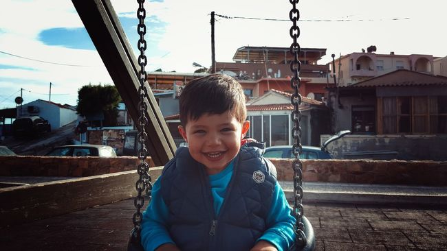 The Portraitist - 2016 EyeEm Awards Little Boy My Son Having Fun Enjoying Life Swinging Childsplay Childhood From My Point Of View Loughing Boy Child Children Photography Kidsphotography Kids Being Kids Found On The Roll