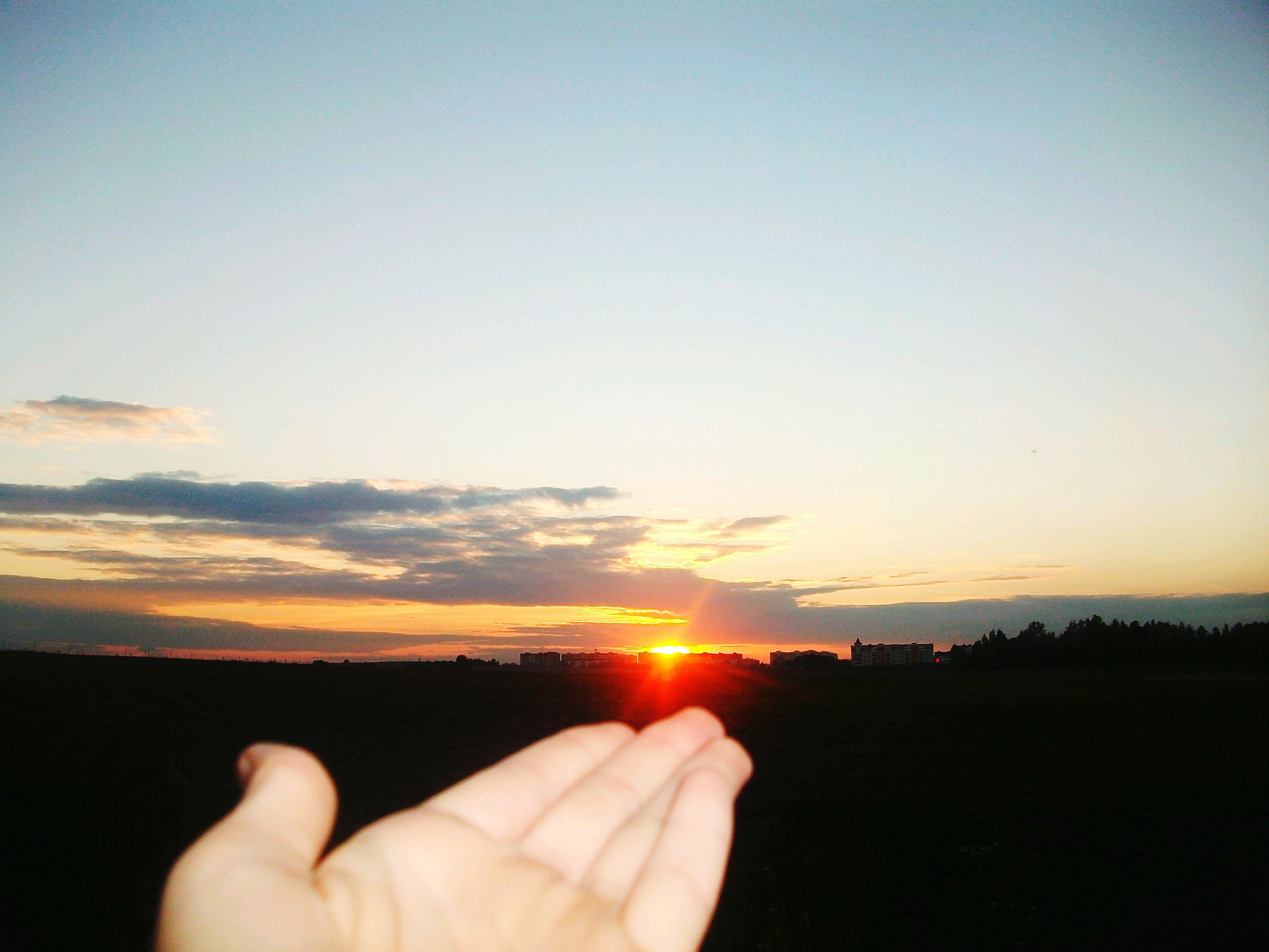 sunset, sun, person, orange color, silhouette, part of, unrecognizable person, sky, sunlight, copy space, cropped, scenics, holding, beauty in nature, sunbeam, personal perspective, human finger