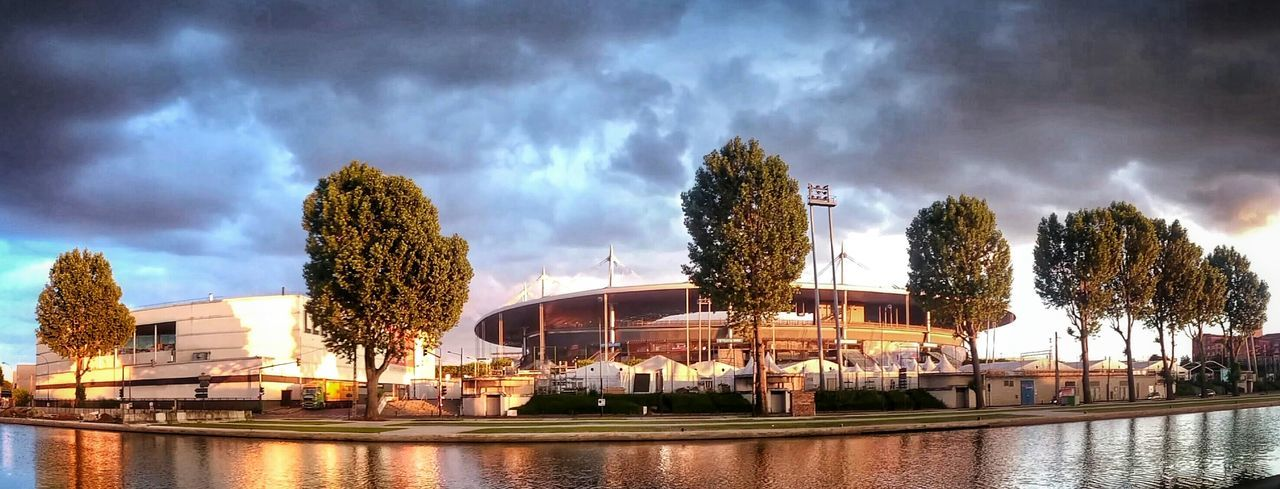 Scanaki Sunny And Strom. Stade De France Just4fun Taking Photos Sony Z2 Landscapes Euro2016 Monument Frankreich Landschaft フランス فرنسا франция Outside Canal Canal De Saint-denis Sdf Panoramic Sky Water Built Structure River No People Cloud - Sky Outdoors Waterfront