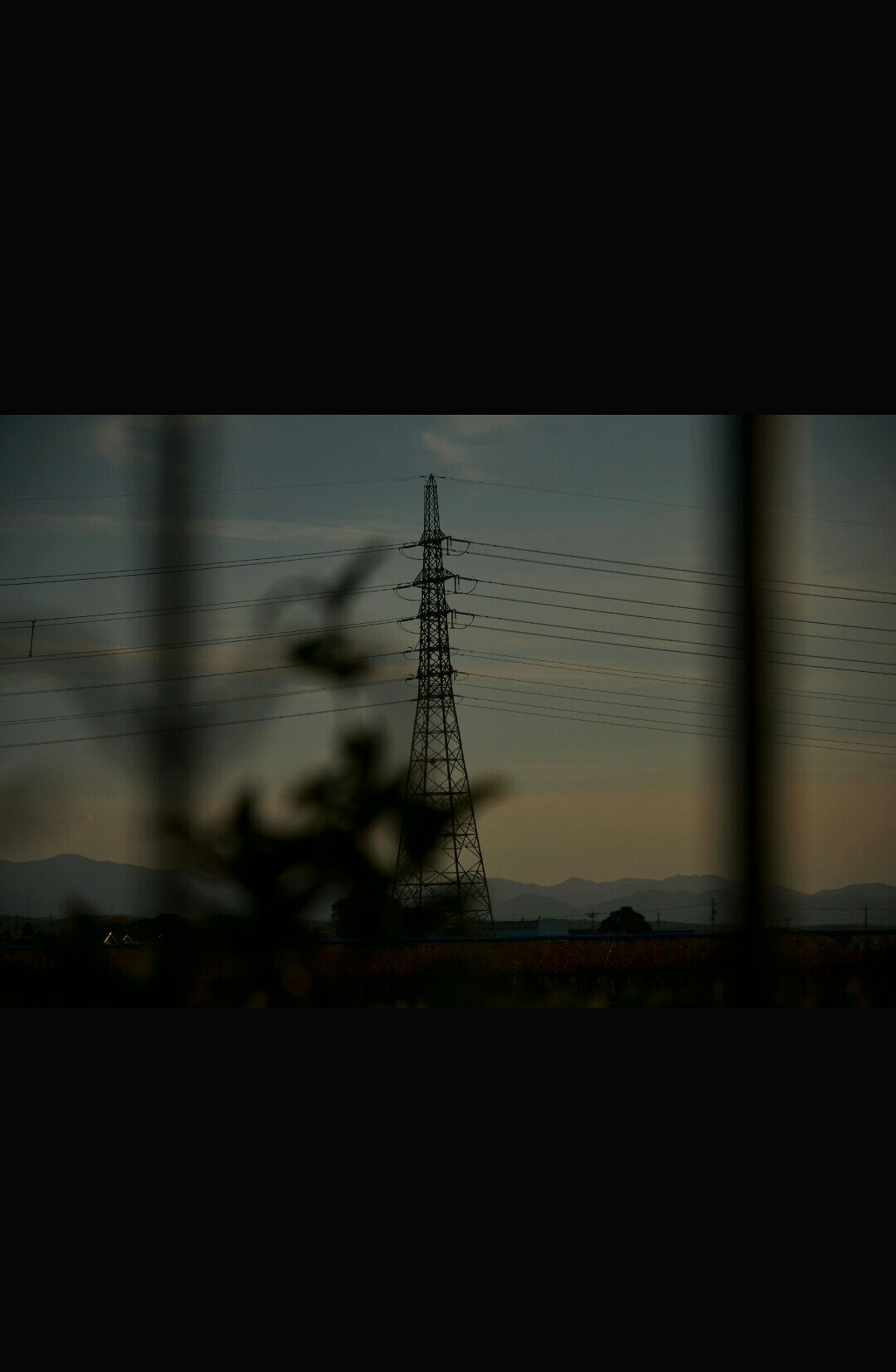 silhouette, sky, built structure, electricity pylon, power line, electricity, fuel and power generation, sunset, water, power supply, connection, indoors, dusk, architecture, technology, nature, no people, dark, window