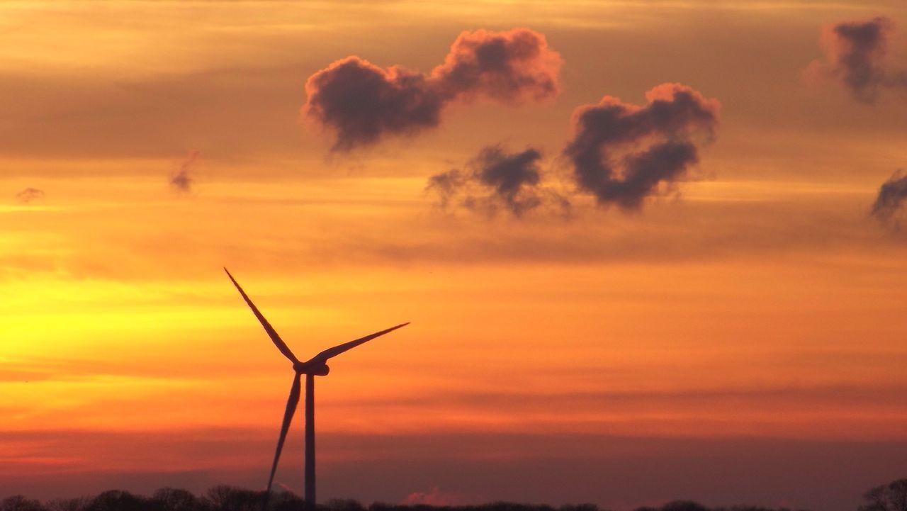 Windmill Against Orange Sky