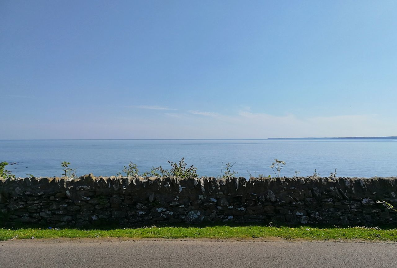 sea, horizon over water, water, nature, tranquil scene, tranquility, beauty in nature, scenics, outdoors, day, no people, sky, blue, plant, growth, beach, clear sky