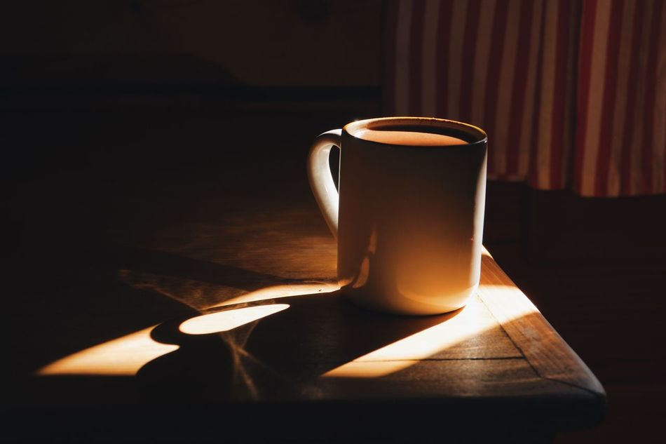 cup of coffee in a morning light Beverage Cabin Coffee Coffee Cup Coffee Time Copy Space Cottage Cup Folk Lodge Morning Morning Light Mug Nobody Object Rustic Shadow Shadows & Lights Wood