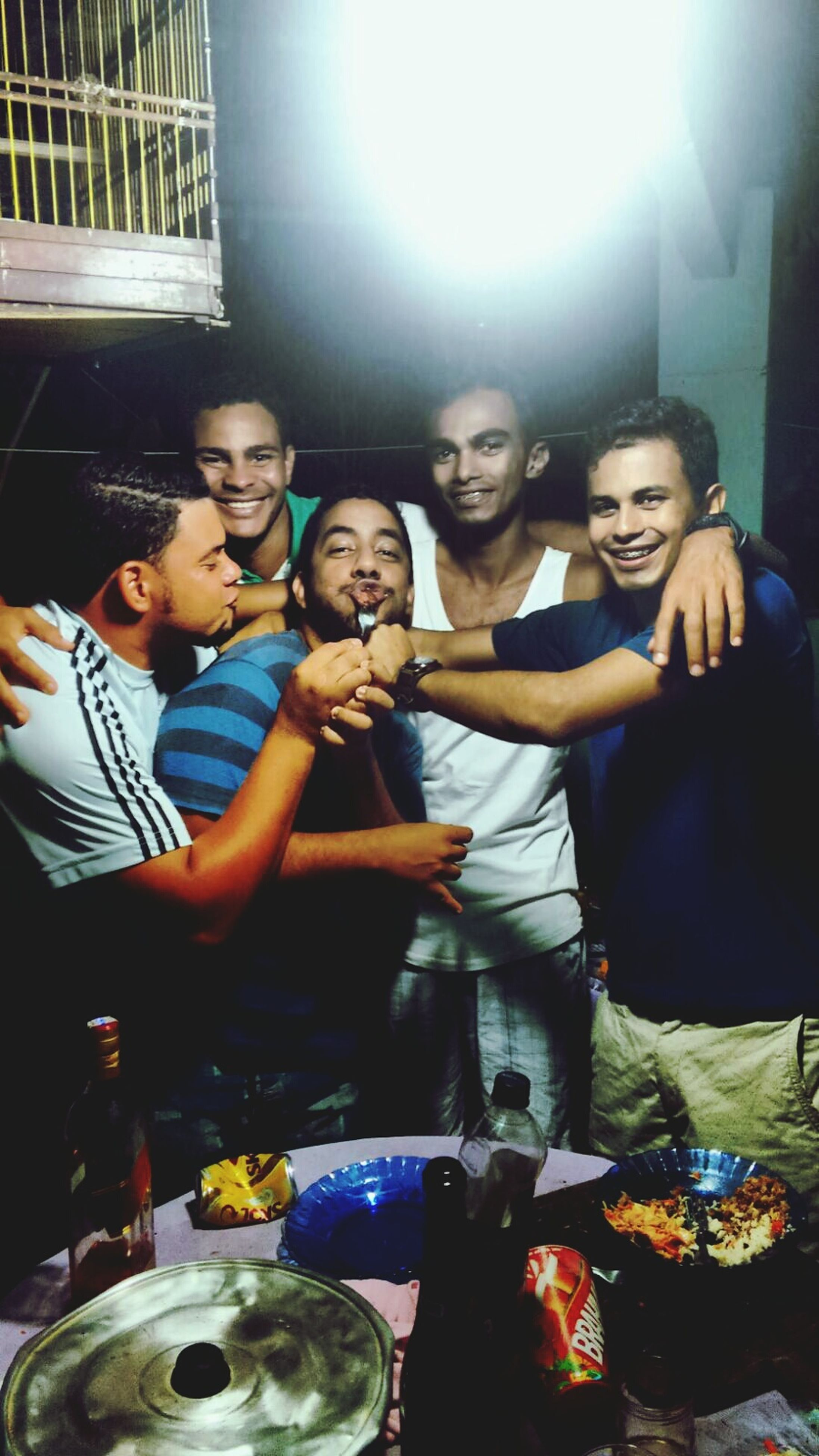 togetherness, person, lifestyles, bonding, leisure activity, young adult, casual clothing, happiness, portrait, looking at camera, indoors, friendship, smiling, young men, love, front view, sitting