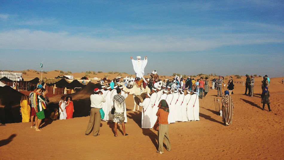 Enjoy The New Normal Large Group Of People Adults Only Outdoors Young Adult Sunlight People Sky Day Desert Dancing People Dancing Taking Photos Desert Music Taragalte Festival Mhamid Morocco Finding New Frontiers