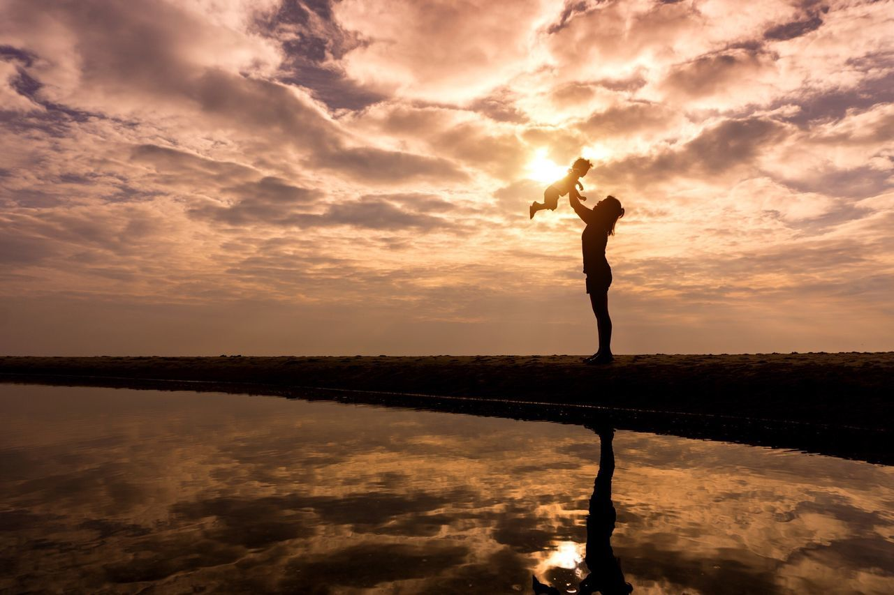 Sunset Reflection Beauty In Nature Standing Nature Mom Mother Family Lifestyle Life Is A Beach Love Mom Day Spirituality Cloud - Sky Sky Lifestyles Lake Tranquil Scene Outdoors Silhouette Freedom Women Tranquility Exercising