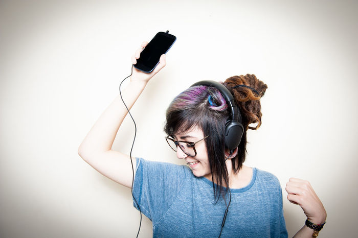 Young alternative teen female listening music and dancing Alternative Dancing Girl Happy Headphones Hipster Human Hair Indoors  Modern Moving Music Listening One Person People Portable Device Preety Teen Teenager Woman Young Adult