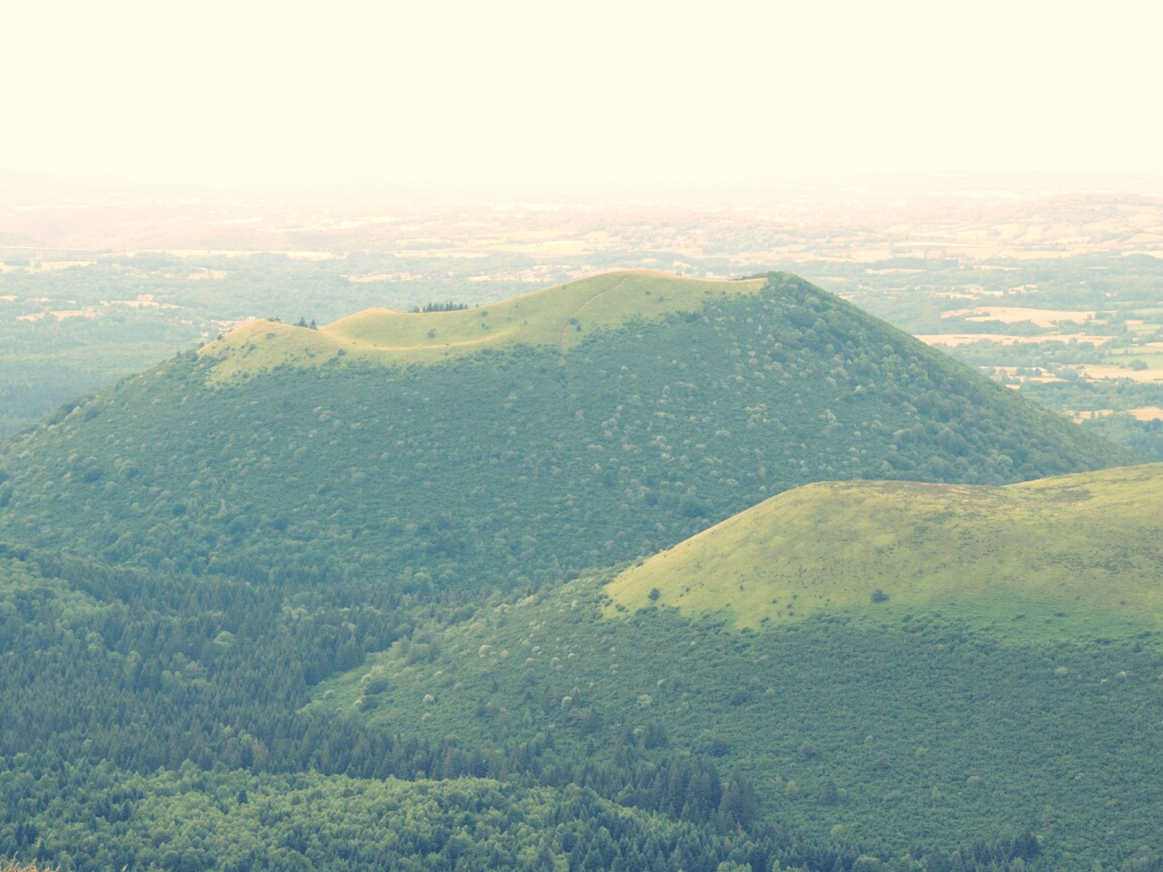 mountain, tranquil scene, scenics, tranquility, landscape, beauty in nature, nature, mountain range, idyllic, non-urban scene, high angle view, sky, fog, remote, day, aerial view, no people, outdoors, green color