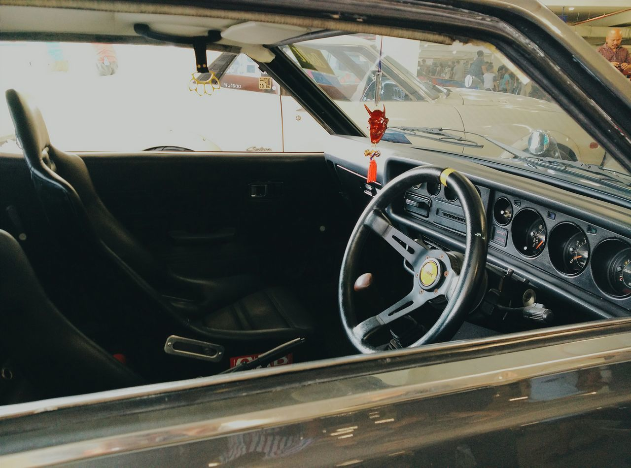 vehicle interior, car, transportation, steering wheel, land vehicle, car interior, mode of transport, dashboard, day, luxury, no people, speedometer, close-up, outdoors