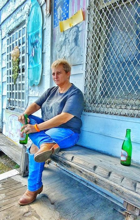 Sitting Full Length One Person Casual Clothing Day Outdoors People Real People Blond Hair Only Women One Woman Only Building Exterior The Week On EyeEm Preston , Kentucky Lgbt Community Country Store Porch Appalachia Cowboy Boots Soda Pop Adults Only Friendship EyeEm Ready   Fashion Stories