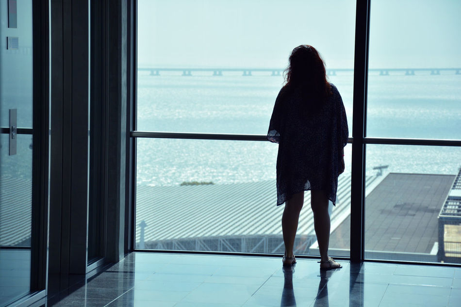 www.idjphotography.com Casual Clothing Contemplation Day Full Length Glass Glass - Material Holiday Hotel Indoors  Journey Looking Looking At View Nature Person Rear View Sea Silhouette Sky Solitude Standing Transparent Vacations View Water Window