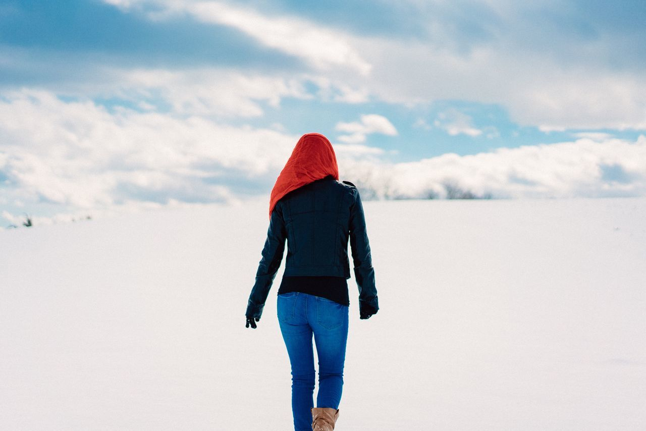 Traveler One Person Snow Rear View Real People Cloud - Sky Sky Winter Cold Temperature Red Full Length Walking Outdoors Day Warm Clothing Nature Women Beauty In Nature Young Adult Hood People