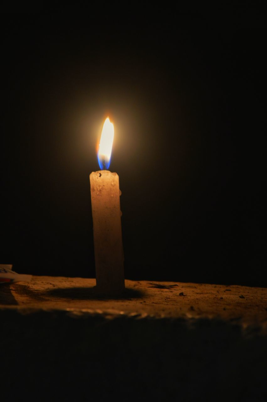 flame, burning, candle, heat - temperature, glowing, illuminated, darkroom, no people, night, close-up, black background, indoors