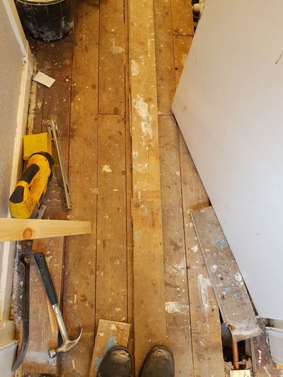 Shoe Yellow Low Section One Person Real People Day Indoors  Adult Human Body Part Floor Wood Floorboards Renovation Working Tradesman Tools Boots
