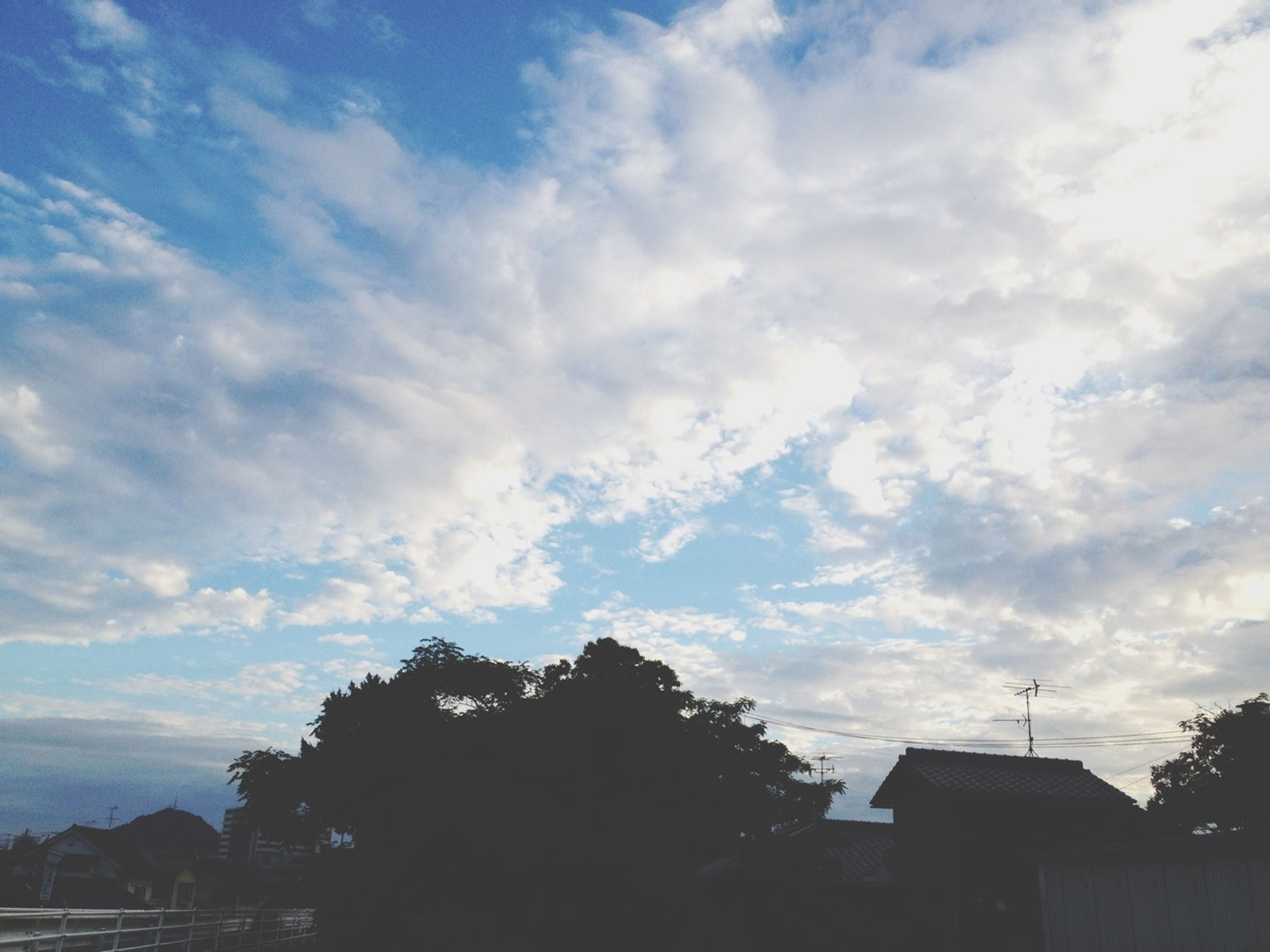 sky, building exterior, tree, built structure, cloud - sky, architecture, house, cloud, cloudy, silhouette, nature, beauty in nature, scenics, residential structure, tranquil scene, tranquility, low angle view, outdoors, residential building, no people