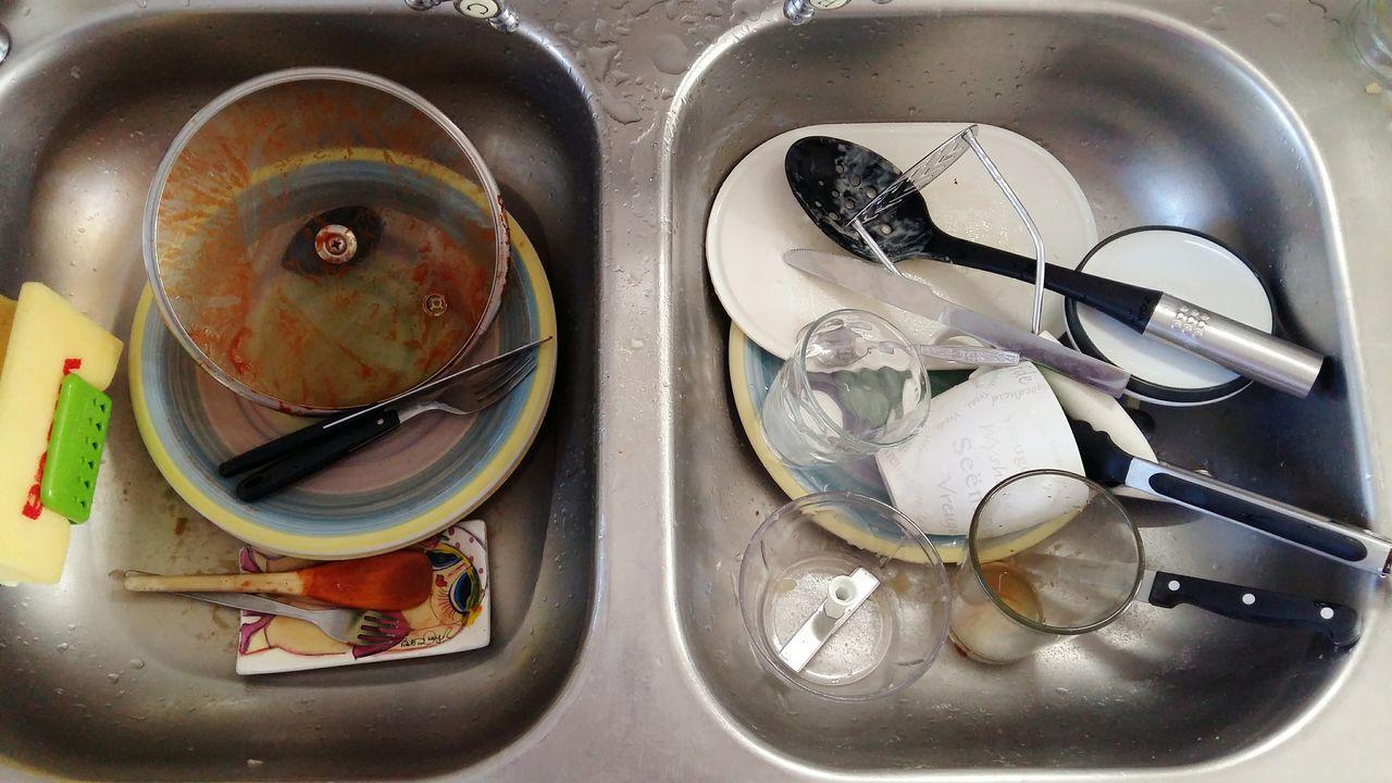 Orderly Mess Arrangement of Dishes Dishwashing
